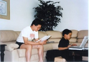 young_father_and_son_laptop